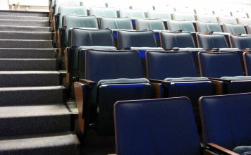 Photograph of empty seats in university lecture hall
