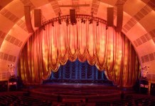photograph of the curtains coming up at Radio City Music Hall