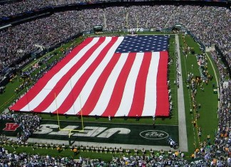 photograph of flag ceremony at NFL football game