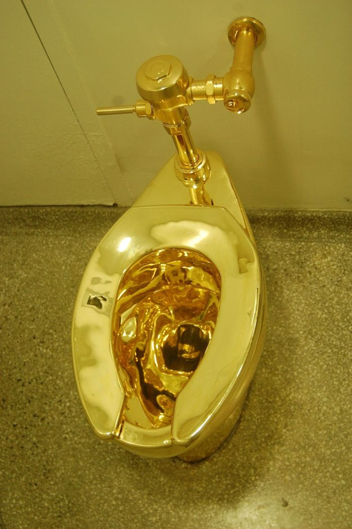 photograph of solid gold toilet America