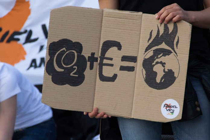 climeme protest sign