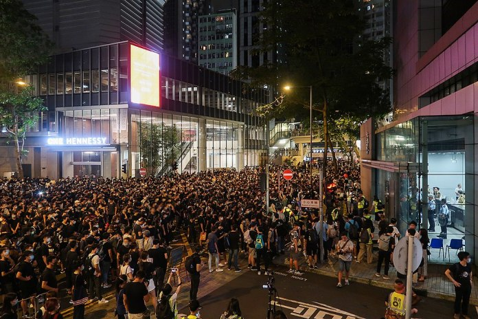 photograph of protest in front of police station