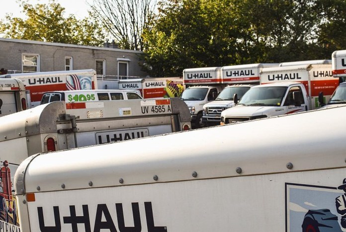 photograph of overcrowded UHaul rental lot