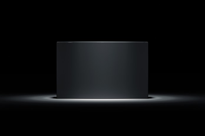 image of black box spotlighted and on pedestal