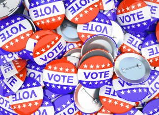 """photograph of pile of """"Vote"""" buttons"""