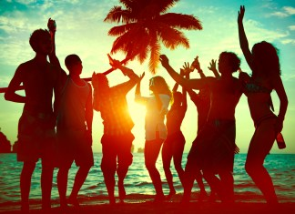 photograph of young people partying as the sun goes down