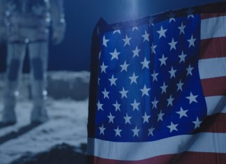 photograph of American flag planted on Moon with Astronaut staring off into space