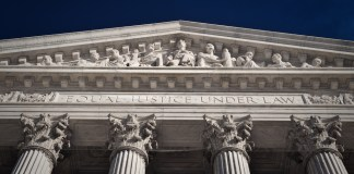 "Detail of the SCOTUS building that reads ""equal justice under law"""