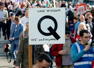 photograph of QAnon sign at rally
