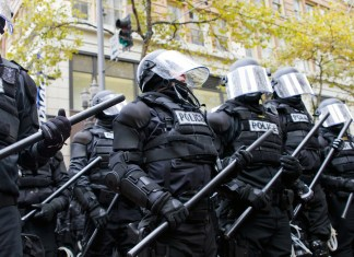 photograph of police in riot gear in Portland