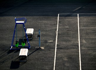 photograph of empty tennis court and judge's chair
