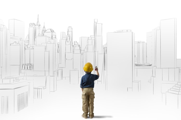image of child architect with hard hat standing in front of sketch of city skyline