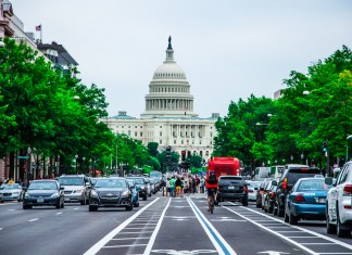 photograph of street traffic leading up to US Capitol building