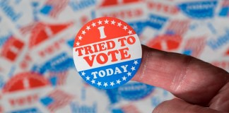 "photograph of an ""I tried to vote today"" sticker"
