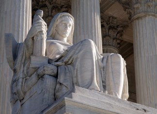 photograph of statue on the steps to the US Supreme Court