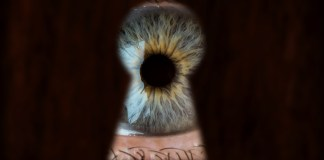 eye looking through keyhole