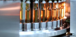 photograph of ampoules in automatic inspection machine conveyor