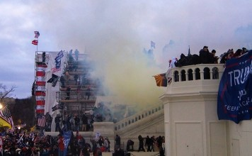 photograph of Capitol mob being tear gassed outside