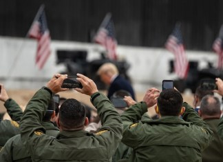 photograph of President Trump leaving podium at border wall event