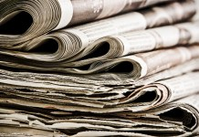 closeup photograph of stack of old newspapers