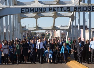 photograph of Selma anniversary march at Edmund Pettus Bridge featuring Barack Obama and John Lewis