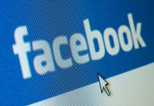 image of Facebook's masthead displayed on computer screen