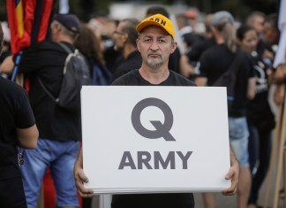 "photograph of 'Q Army"" sign displayed at political rally"