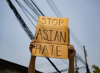 """photograph of """"Stop Asian Hate' sign being held"""