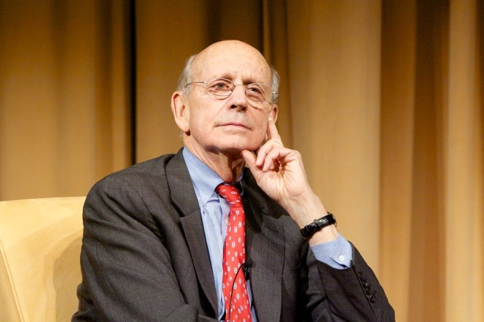 photograph of a contemplative Justice Breyer at a speaking engagement