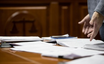 photograph of the defense's materials on table in a courtroom