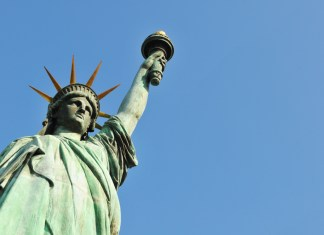 photograph looking up at Statue of Liberty