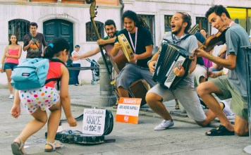 photograph of buskers celebrating child's donation
