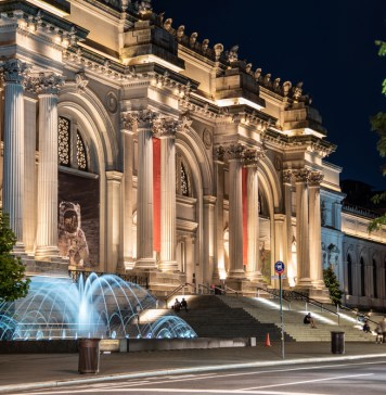 photograph of the lighted front of the Metropolitan museum of art at night