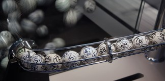 photograph of lottery balls coming out of machine