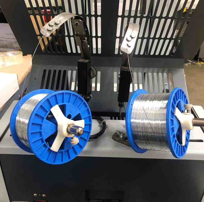 Saddle Stitched wire spools are used for binding the collated sheets together to form a booklet.