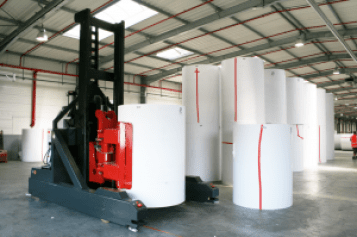 Large rolls of paper use for web-fed offset printing.