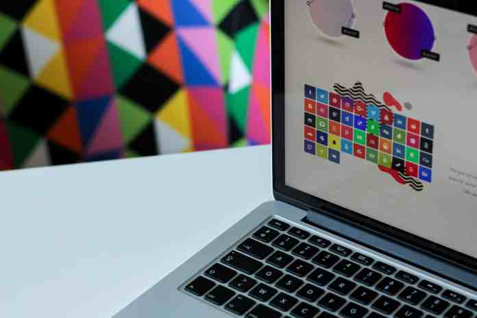 Laptop with colorful graphic design software