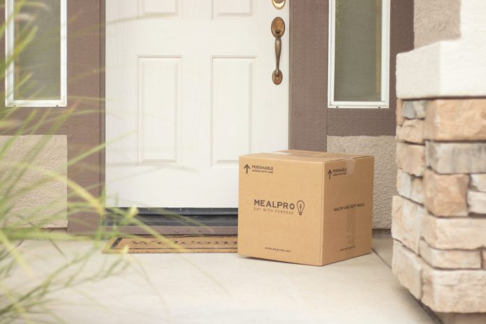 Custom shipping box delivered to front door