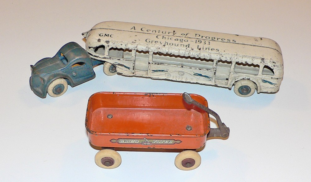 Cast-Iron Greyhound bus and steel Radio-Flyer toys sold at the fair.