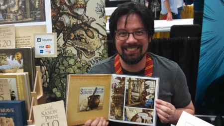 Petersen holds Mouse Guard.