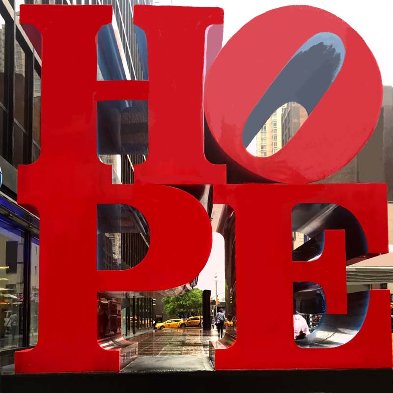 """""""Hope"""" sculpture by Robert Indiana at the intersection of 53rd Street and 7th Avenue in Manhattan"""