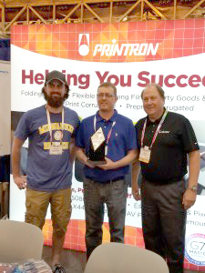 Westrock Adams employees and Printron's Rick Pomerenka with the Best Of Show award.