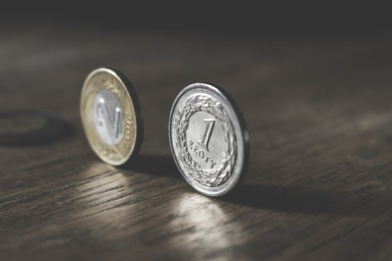 two gold colored and silver colored coins