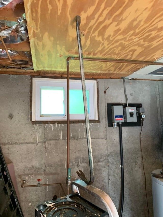 OSHA fail: A crowbar holding up a board.