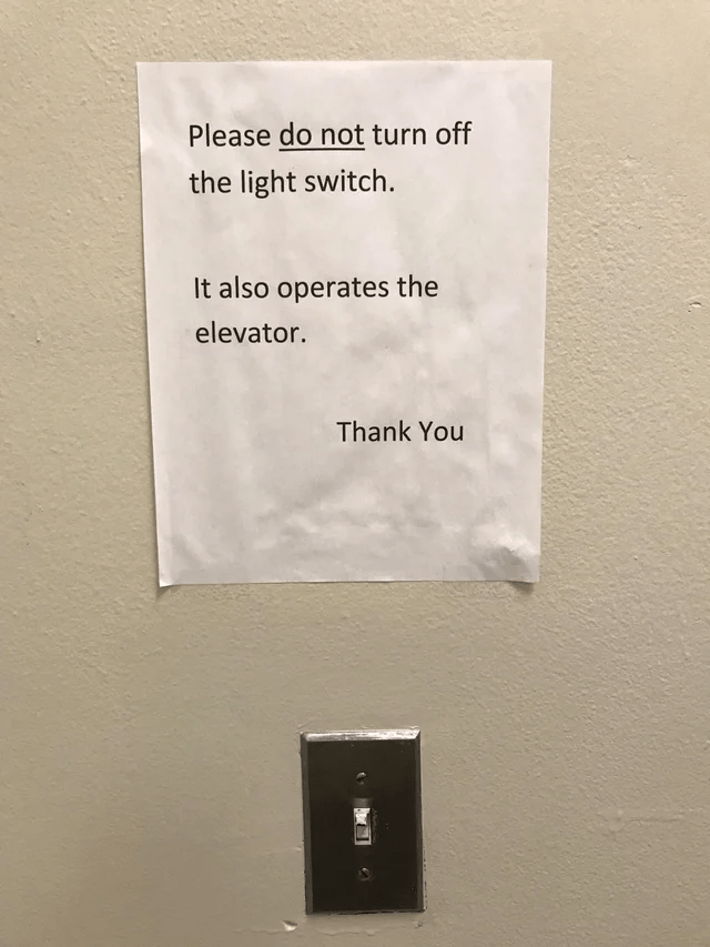 "OSHA fail: A sign reading ""Please do not turn off the light switch. It also operates the elevator. Thank You """