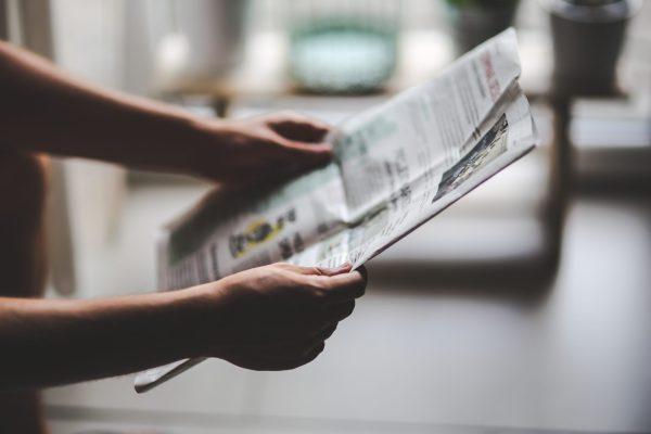 Someone reads a newspaper