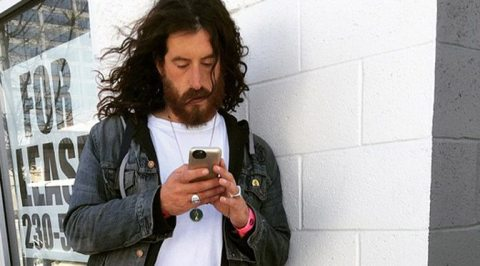 Man looking at his cell phone