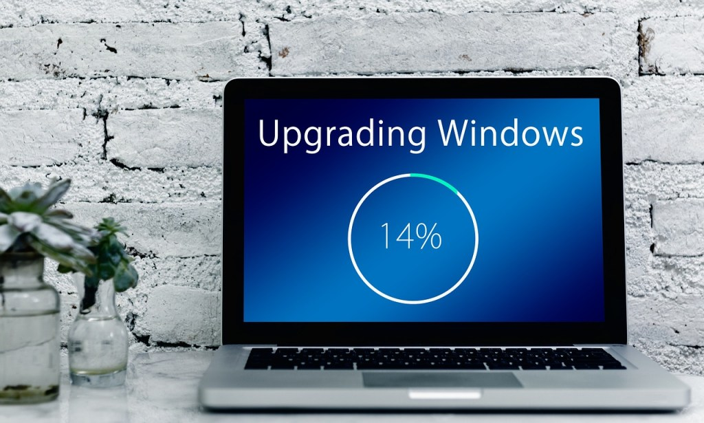 An image of a laptop in the middle of updating its install of Windows.