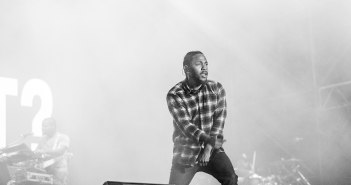 Kendrick Lamar appears on stage during a performance.