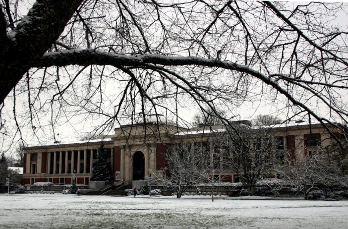 An image shows the memorial union building at OSU covered in snow.